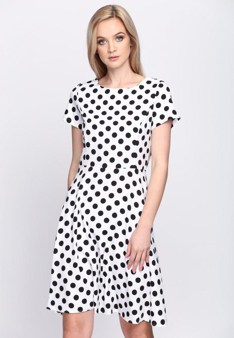 704acb73d35e Biele bodkované šaty Avery