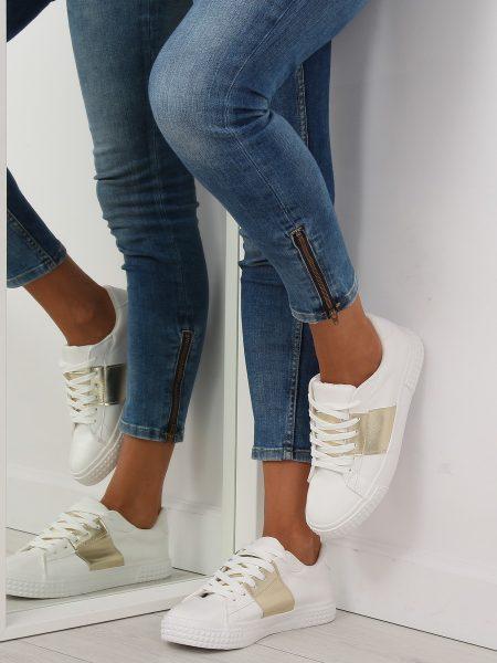 Dámske tenisky v bielo-zlatej farbe Linda Veľkosť : 36, 37, 38, 39, 40, 41 /podľa dostupnosti/ Farba: bielo-zlatá Špička topánky: okrúhla uzavretá Upevnenie: šnúrovacie Kód produktu: Jarka JA20896Z